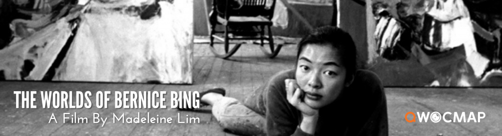 A black and white photo of Bernice Bing, an Asian woman with long black hair wearing paint-spattered pants. She lounges on the wood-paneled floor and gazes into the camera. Behind her, large abstract paintings lean against the wall. The QWOCMAP logo is in the bottom right corner, and in the bottom left white text reads The Worlds of Bernice Bing, A Film By Madeleine Lim.