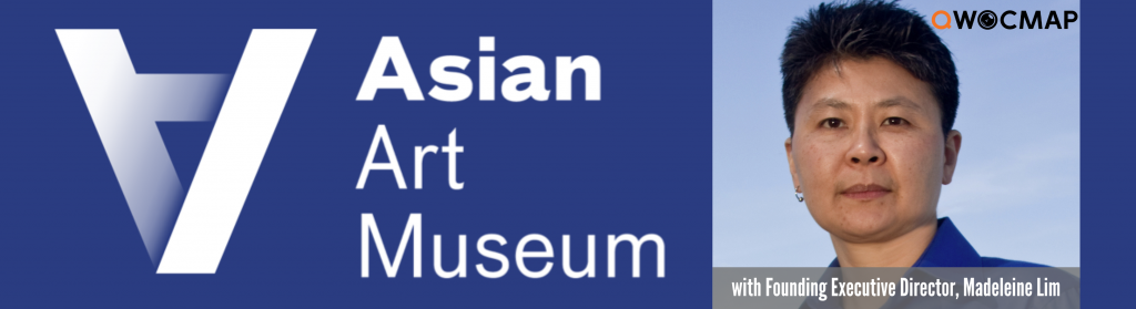 On a navy background, white text reads Asian Art Museum. To the left is the Asian Art Museum logo. On the right is a headshot of an Asian person with light brown skin, short black and gray hair, and brown eyes, wearing a bright blue collared shirt and one earring. On the photo, the QWOCMAP logo is in the top right corner and the caption, which is white text on a gray transparent background, reads With Founding Executive Director Madeleine Lim.
